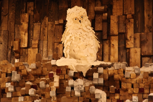 Winter Owl Perched High on a Wall of Wood2