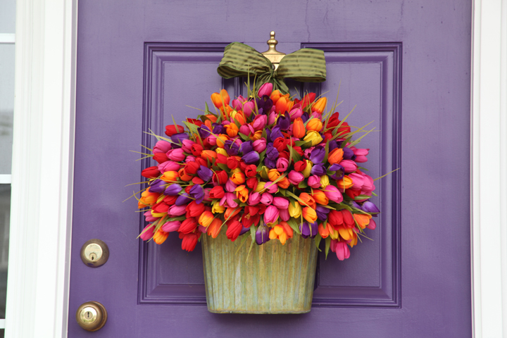 Purple front door and colorful tulip bouquet