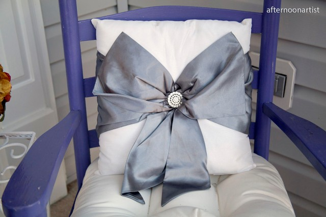 holiday pillow with big silver bow